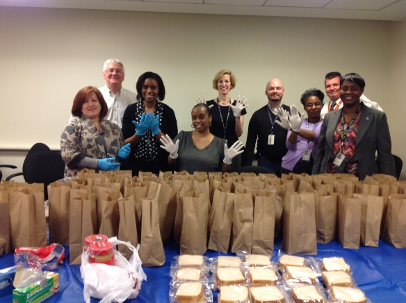 DHS Employees Pack Bagged Meals for Those in Need